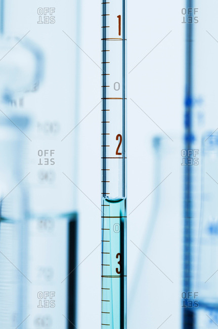 Meniscus. Curved surface (meniscus) of water in graduated pipette. Liquid volume measured by reading the scale at the bottom of the meniscus. The reading is 2.37 mL