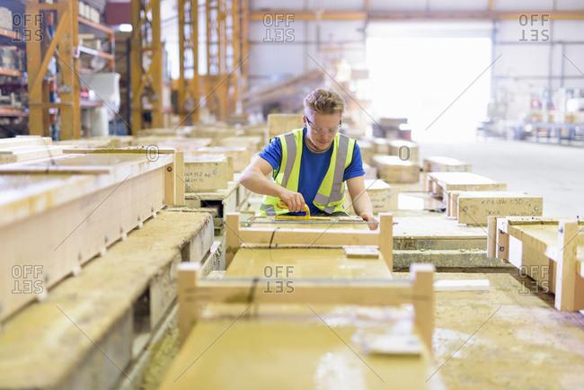 Apprentice molding stone in architectural stone factory