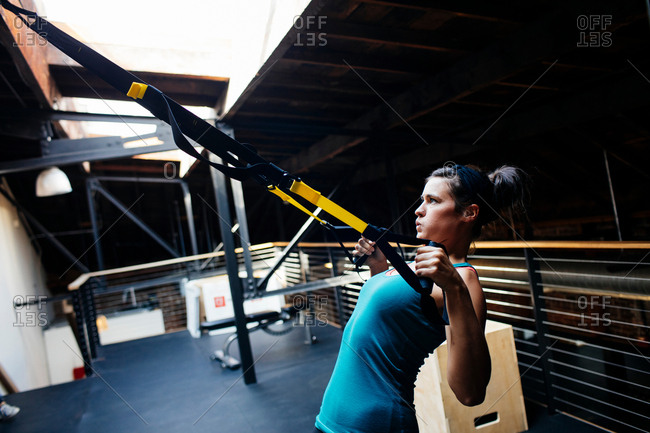 Woman using resistance bands in gym