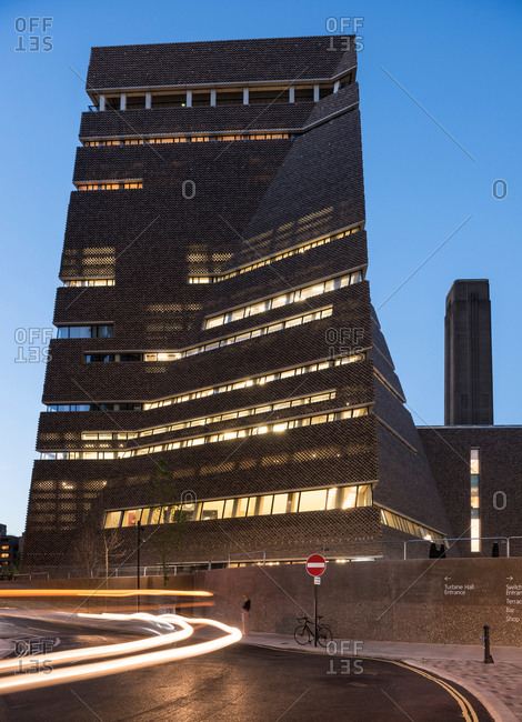 London, UK - October 3, 2016: Dusk view of traffic passing Switch House exterior, Tate Modern, London, UK