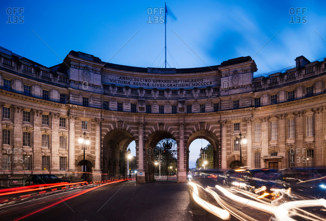 Traffic light trails at Admiralty Arch at dusk, London, UK
