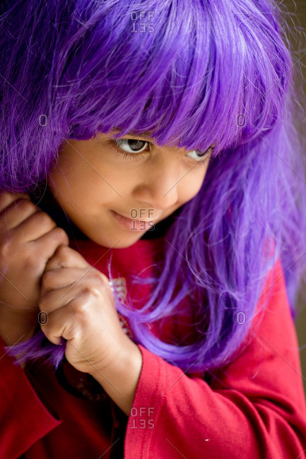 Young girl in a purple wig