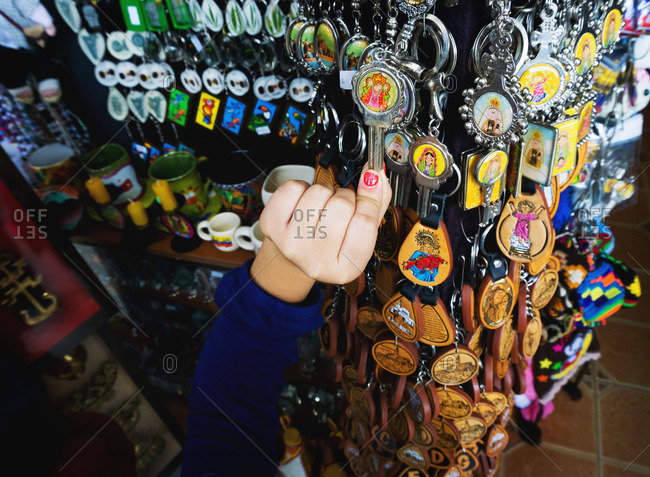 Hand with keychains at market, Colombia