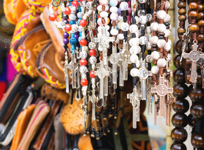 Rosaries hanging in market at Monserrate, Colombia