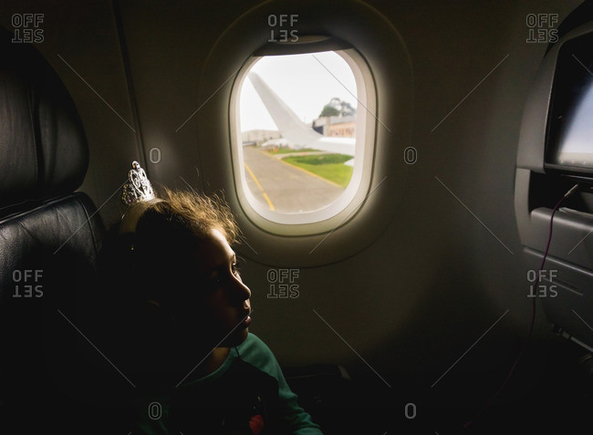 Girl watching in-flight entertainment