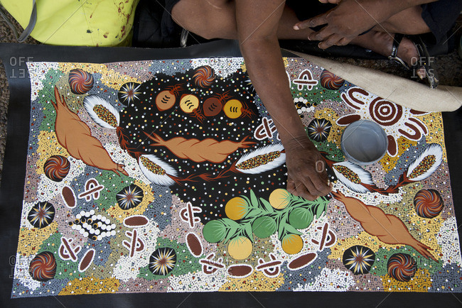 Darwin, Australia - December 7, 2015: Detail of an artist painting in a traditional aboriginal style, in Darwin, Australia