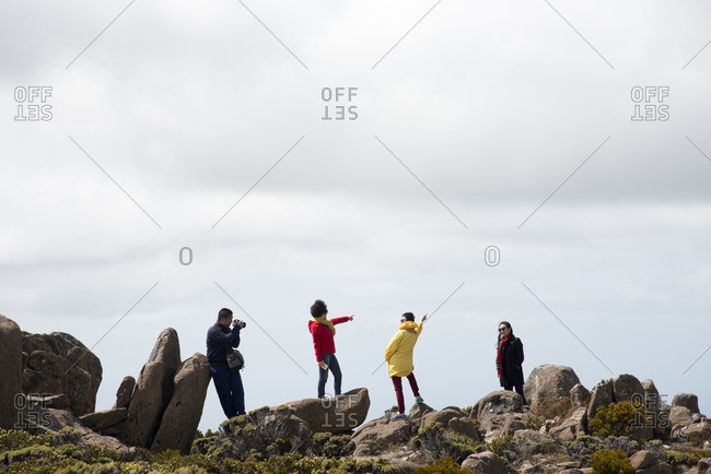 Hobart, Tasmania, Australia - December 10, 2015: People posing on Mount Wellington