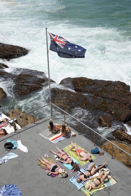 Sydney, Australia - December 11, 2015: People lounging on ocean deck