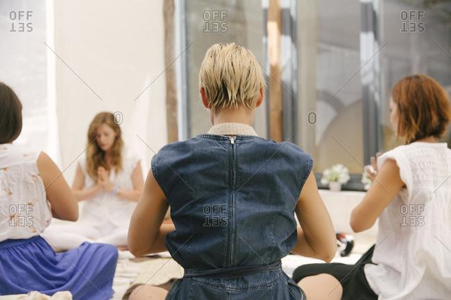 Women in meditation together