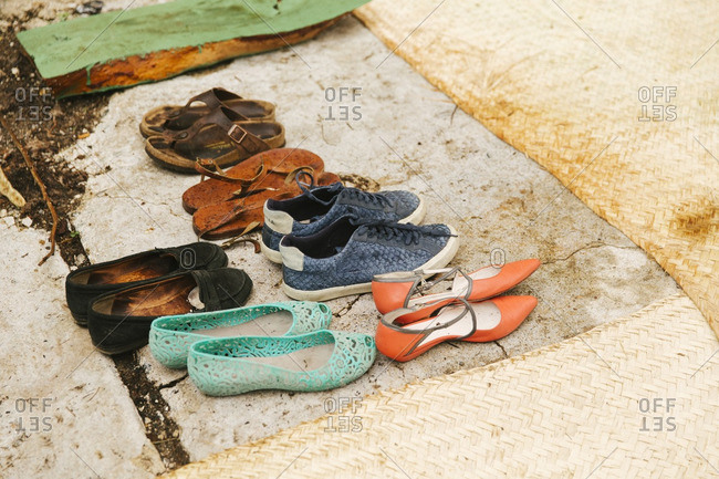 Pairs of shoes near mats