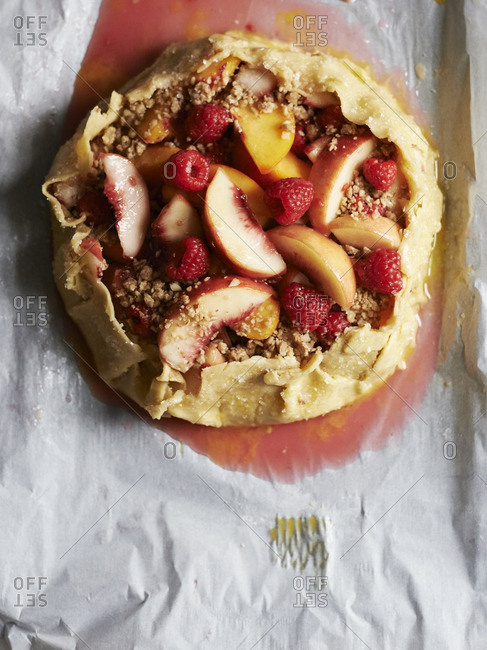 Oven ready peach, raspberry and almond crumb galette