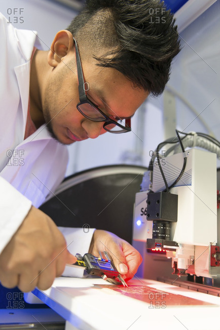 Engineer at work in an electronics lab