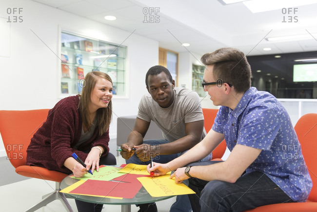 Students in a university setting, working together.