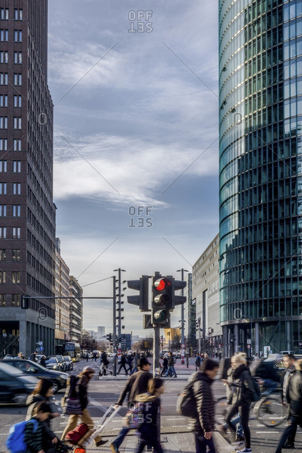 Many pedestrians crossing street on Potsdamer Platz
