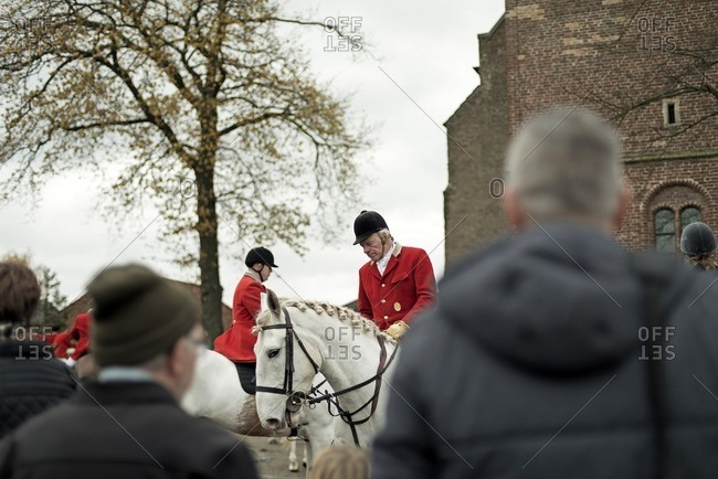 Geesteren, Achterhoek, Gelderland, The Netherlands - November 19, 2016: Horse riders gather at church of village at start of drag hunting.