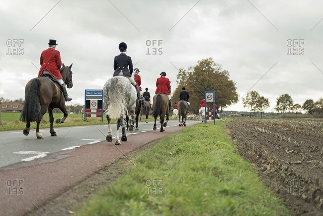 Geesteren, Achterhoek, Gelderland, The Netherlands - November 19, 2016: Horse riders leaving village for drag hunting.
