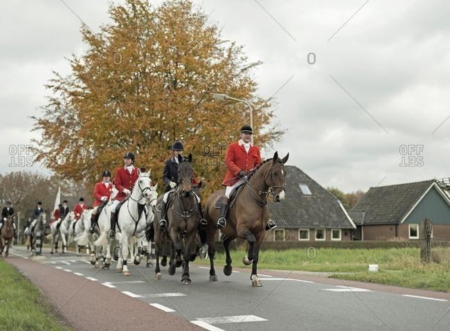 Geesteren, Achterhoek, Gelderland, The Netherlands - November 19, 2016: Horse riders leaving village for drag hunting.