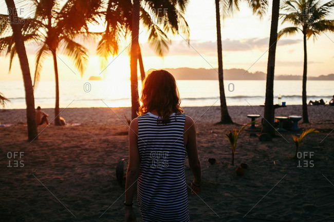 Woman walking on Carillo Beach, Costa Rica
