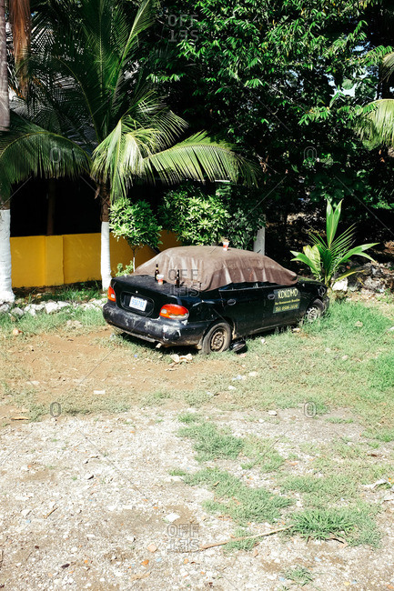 Conchal, Costa Rica - November 16, 2015: Abandoned car