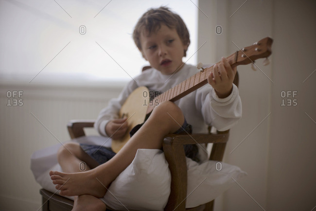 Young boy playing the banjo.