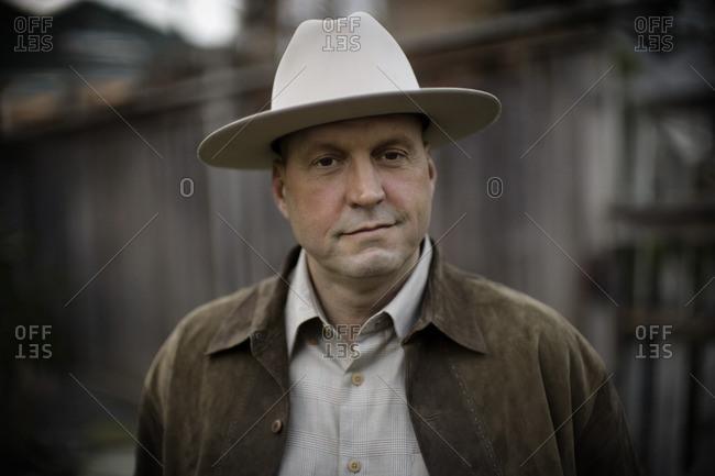 Man wearing a cowboy hat.