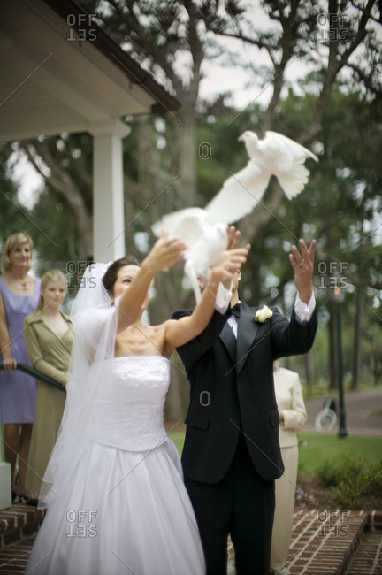 Bride and groom releasing doves on their wedding day.