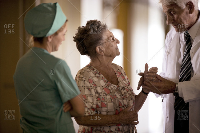 Senior woman being examined by a doctor and nurse.