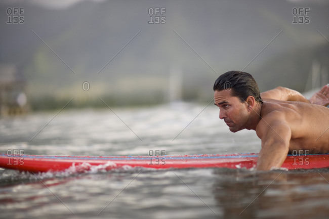 Surfer paddling out.
