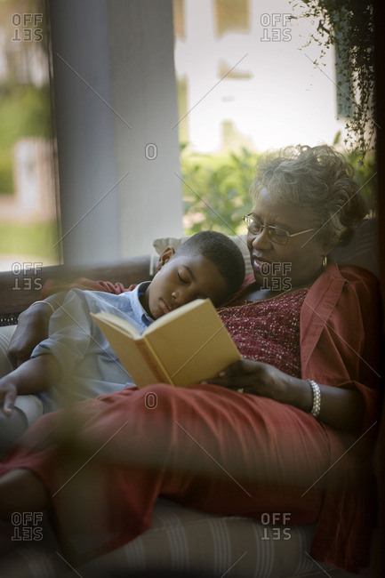 Grandmother reading to her grandson.