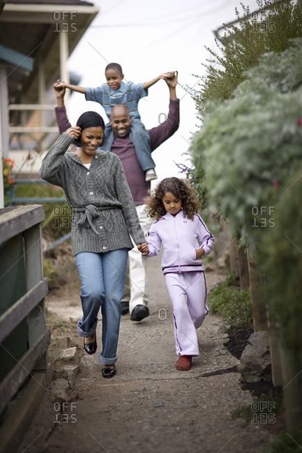 Family walking down a footpath together.