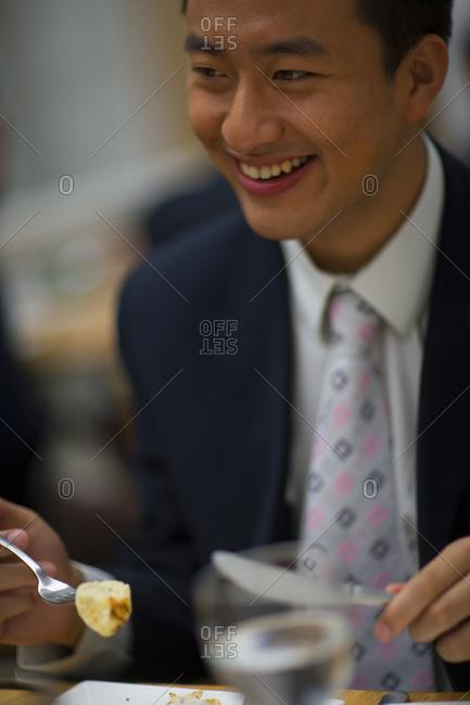 Businessman enjoying lunch at a restaurant.