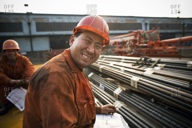 Smiling construction workers on site.