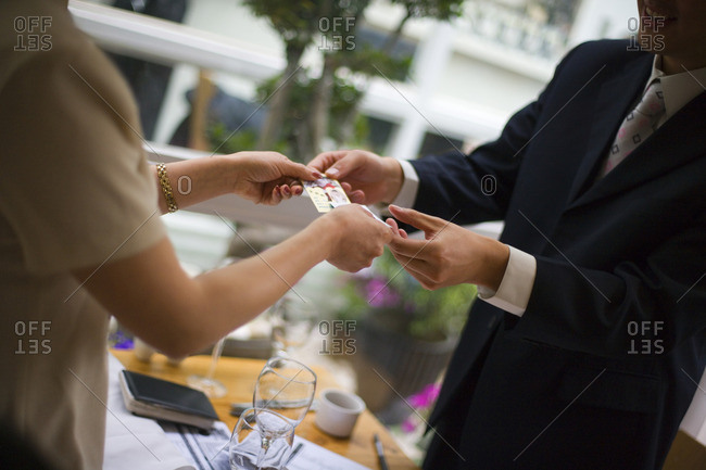 Businessman receiving a gift during a business lunch.