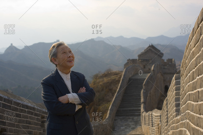Senior businesswoman at the Great Wall of China.