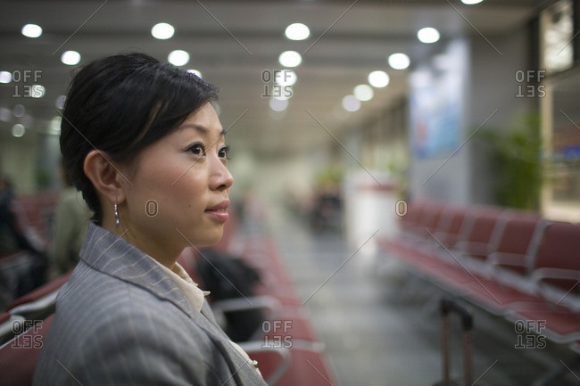 Businesswoman waiting in an airport gate.