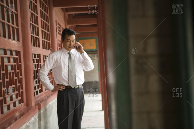 Businessman talking on a cellphone.