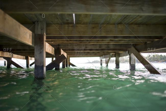Underneath a wooden pier.