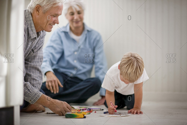 Grandparents coloring in with their grandson.