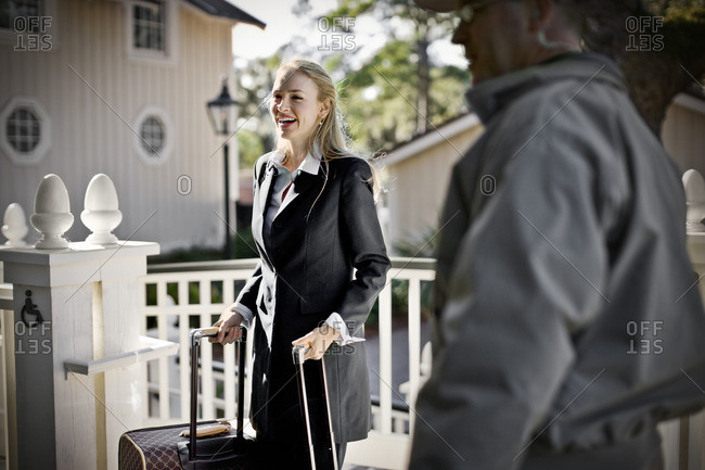 Businesswoman about to leave for a business trip.
