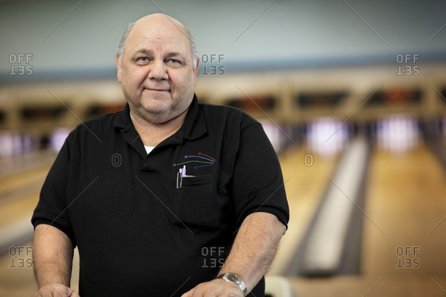 Worker in a bowling alley.