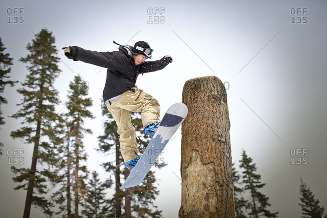 Snowboarding performing a jump.