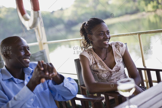 Couple enjoying a boat ride.