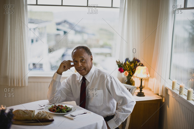 Man sitting down to dinner after work.