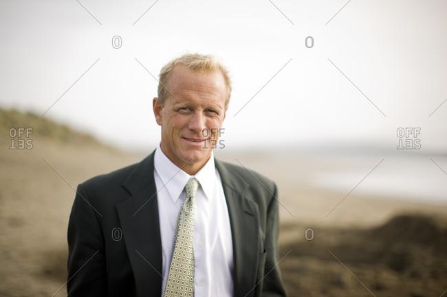 Businessman on the beach.