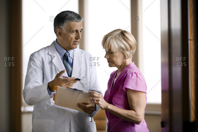 Doctor speaking with his assistant.