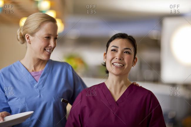 Two nurses smiling while taking a break.