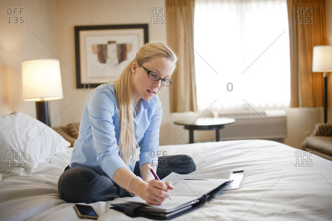 Businesswoman writing in a diary.