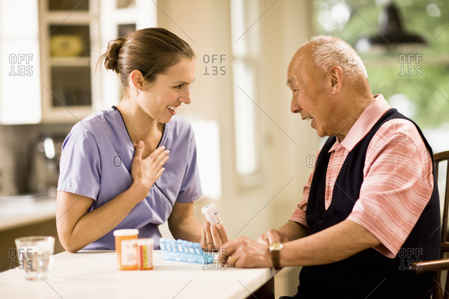Nurse discussing medication with a senior patient.