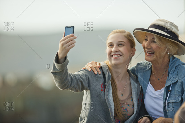 Grandmother and granddaughter taking a selfie together.