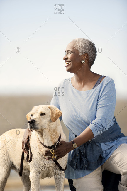 Woman with her dog at the beach.